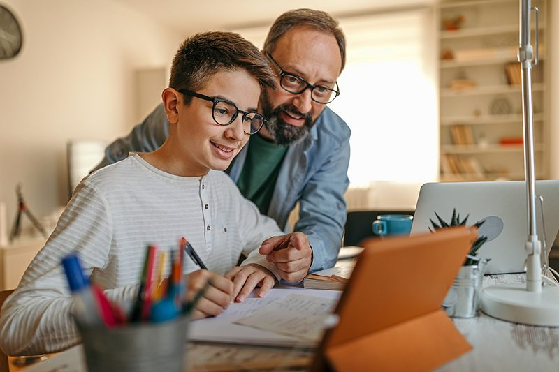 Parent helping student with online class