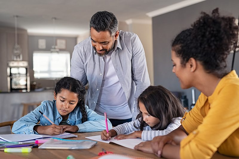 Parents helping students with school work